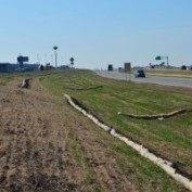 9 inch and 12 Inch Bio-Logs Biodegradible Curlex American Excelsior Straw Wattle Highway Project I-135 Wichita, Kansas Challenger Construction 20 Inch Bio-Log Ditch Checks