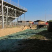 Installation of Erosion Control Blanket over Hydroseeded areas Athletic Field Bleacher Addition North East High School Wichita Kansas Challenger Construction